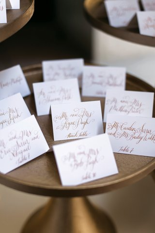 escort-card-with-fancy-script-gold-calligraphy