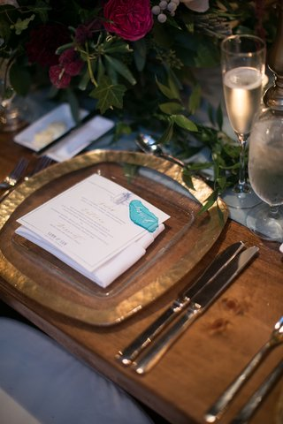 wedding-reception-wood-table-gold-charger-plate-blue-sea-glass-place-card-greenery-runner