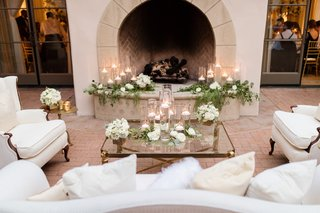 the-resort-at-pelican-hill-wedding-reception-liunge-area-in-front-of-fireplace-candles