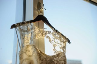 custom-dress-hanger-with-brides-married-name-monique-lhuillier-keyhole-back-wedding-dress