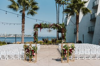 long-beach-wedding-ceremony-arch-between-two-palm-trees-fall-wedding-color-scheme