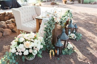 rustic-chic-sweetheart-table-winery-vines-lanterns-southern-california-wedding