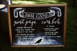 halloween-wedding-reception-lawn-games-giant-jenga-corn-hole-chalkboard-sign-raven-crow