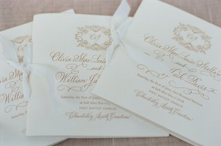 white-ceremony-booklets-with-gold-lettering