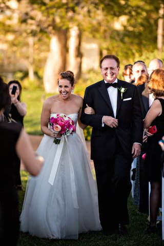 bride-in-strapless-ball-gown-walks-down-aisle-with-father