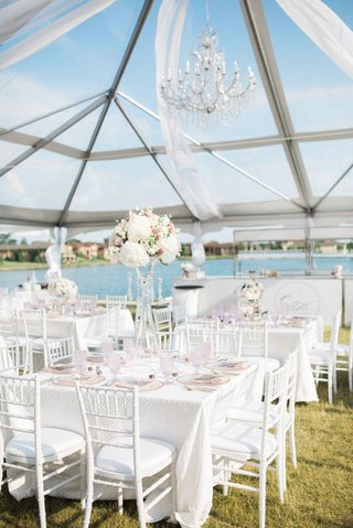 tented-reception-by-a-country-club-pond-white-linens-blush-details