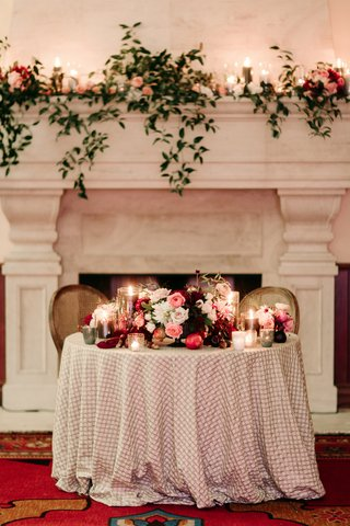 sweetheart-table-in-front-of-fireplace-textured-linens-fall-wedding-inspiration