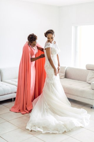 maid-of-honor-in-purple-lagos-coral-dress-with-cape-helps-bride-in-lace-dress