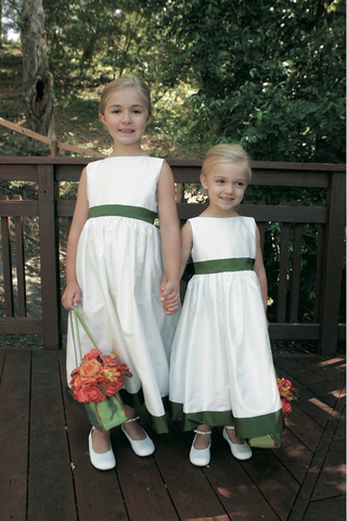 flower-girls-in-white-dresses-with-green-baskets