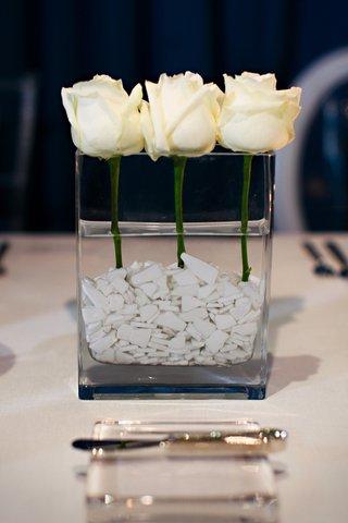white-single-roses-in-rectangular-vase