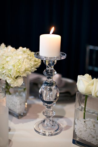 white-candle-on-clear-candlestick