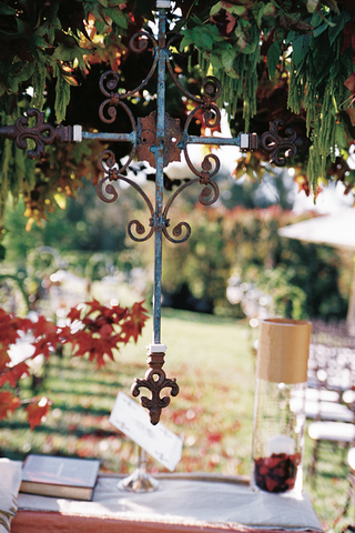 wrought-iron-cross-hanging-from-outdoor-ceremony-structure