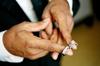 african-american-groom-with-wedding-rings-on-fingers