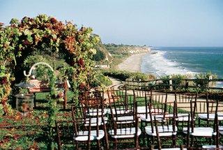wedding-ceremony-on-ocean-bluff-at-bacara-resort-spa