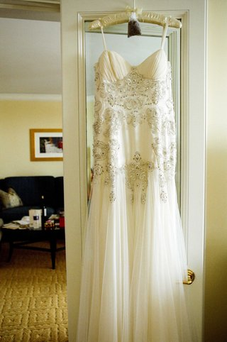 bead-bodice-bridal-gown-hanging-in-bridal-suite