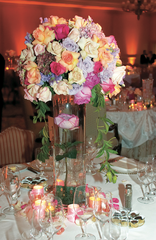 bouquet-of-different-colors-of-roses-on-large-glass-vase