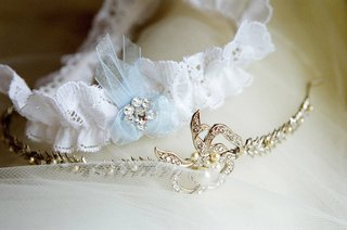 lace-garter-next-to-gold-and-diamond-tiara