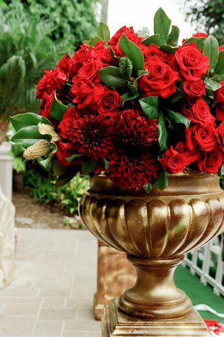 gold-vessel-filled-with-red-roses-and-dahlias