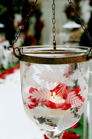 etched-glass-vessel-filled-with-votive-candle-and-roses