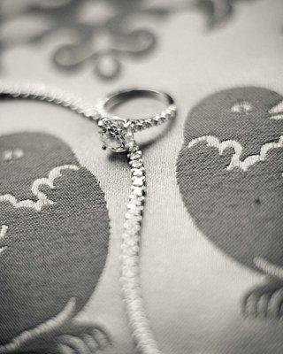 black-and-white-photo-of-round-diamond-engagement-ring