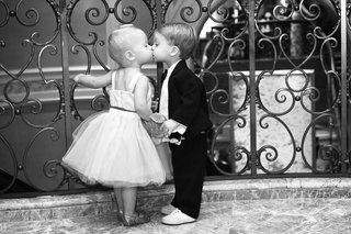 black-and-white-photo-of-flower-girl-and-ring-bearer-kiss