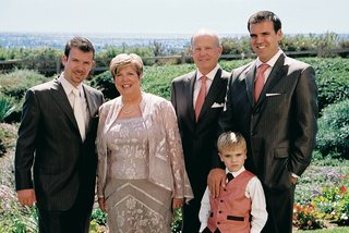 father-of-groom-in-pinstripe-suit-and-mother-of-groom-in-floral-ensemble
