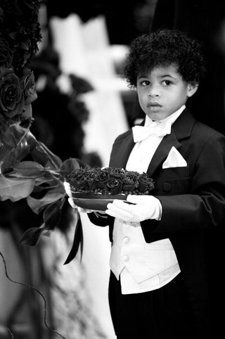 black-and-white-photo-of-boy-wearing-tux-and-gloves