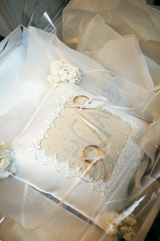 white-and-ivory-cushion-with-rings-on-ribbon
