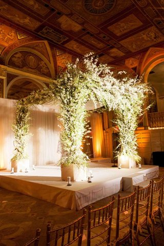 chuppah-decorated-with-white-flowers-and-greenery
