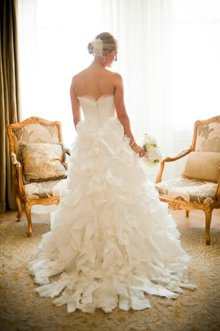strapless-bridal-gown-with-ruffled-skirt-on-blonde-bride