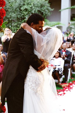 sherry-jackson-gordy-and-groom-kissing