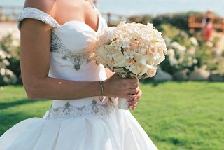bouquet-of-white-and-pink-flowers-carried-by-bride