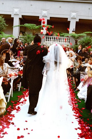bride-and-groom-exit-among-rose-petal-toss