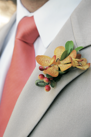 grooms-wedding-boutonniere-with-yellow-orchid