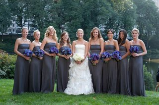 bride-with-grey-bridesmaid-dresses-and-purple-blue-flowers