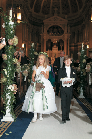 cute-boy-and-girl-walking-down-church-aisle