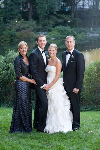 mother-of-groom-in-bolero-jacket-and-father-in-tux