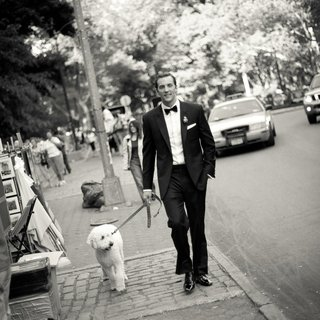 black-and-white-photo-of-groom-walking-dog-in-nyc