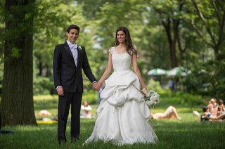 bride-in-a-monique-lhuillier-gown-with-a-pick-up-skirt-and-groom-in-a-black-tuxedo