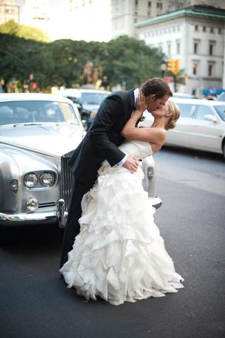 bride-and-groom-kiss-in-front-of-classic-car-in-nyc