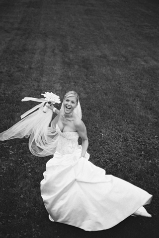 bride-wearing-strapless-embroidered-bodice-wedding-dress