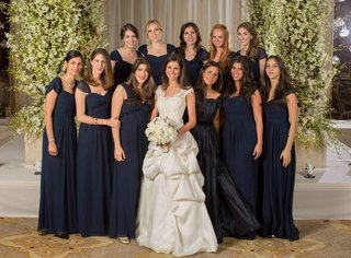 bride-in-a-monique-lhuillier-gown-with-bridesmaids-in-long-navy-blue-monique-lhuillier-dresses