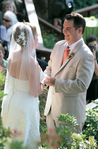 bride-and-groom-hold-hands-at-alfresco-wedding-ceremony