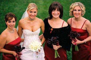 bridesmaids-in-red-dresses-with-fur-boleros