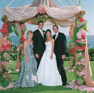 chuppah-made-of-ivory-fabric-and-pink-and-green-flowers