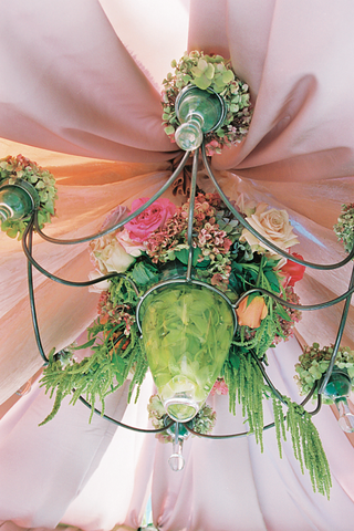 chandelier-covered-in-green-vines-and-pink-flowers