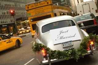 wedding-car-with-just-married-sign-and-leaf-garland