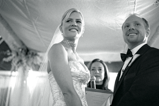black-and-white-picture-of-couple-at-wedding-ceremony-altar