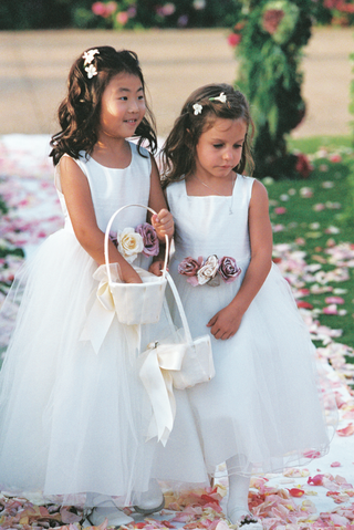 flower-girls-wearing-white-dresses-with-purple-flowers