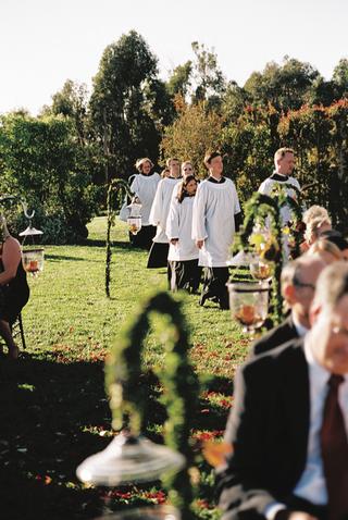 church-choir-members-perform-in-white-robes-at-wedding